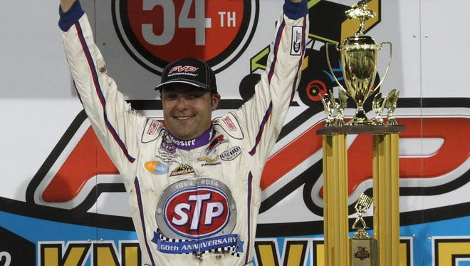 Donny Schatz celebrates with his $150,000 first-place check after winning the 54th Annual Knoxville Nationals. Schatz won for the eighth time in nine tries at the event.