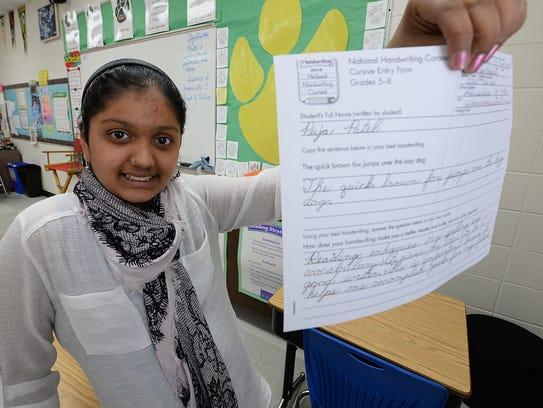 Puja Patel shows her award-winning handwriting she