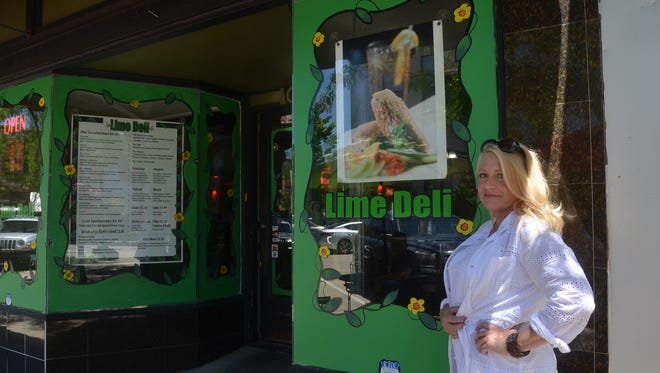 Cheryl Jenkins has painted the windows of many Gallatin businesses, including the Lime Deli.