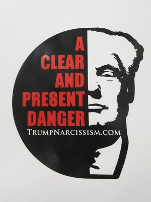 Publishers of a book on Donald Trump and narcissism are distributing this sticker.