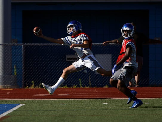 Walled Lake Western's Justin Thomas gets his hand on