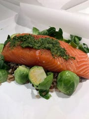 Salmon fillet topped with compound butter, rice or