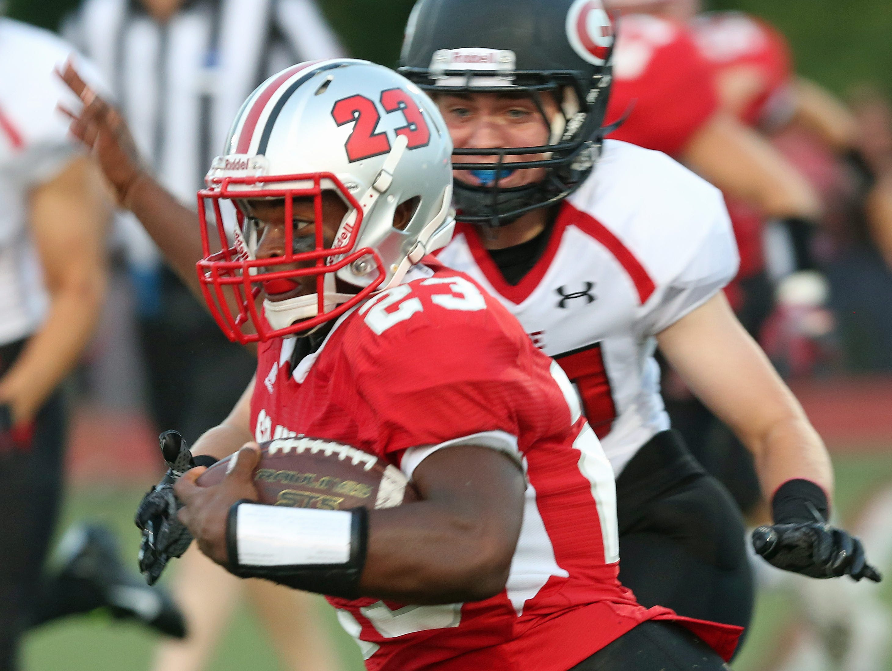 Somers's Messiah Horne (23 ) finds some running room in the Rye defense during first half action at Somers High School Sept. 4, 2015