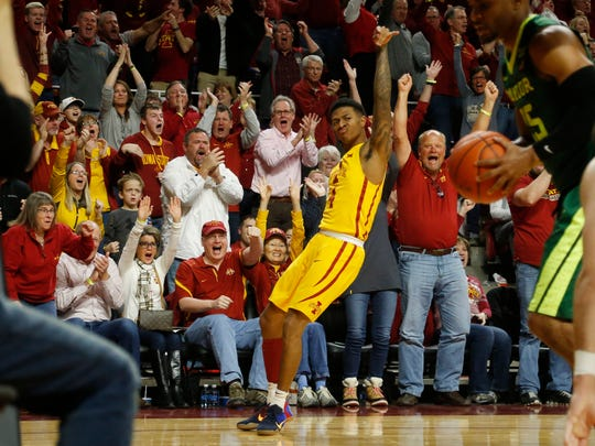 Fans explode on the sideline as Iowa State guard Donovan Jackson (4) sinks a three-point shot in the second half Saturday, Feb. 25, 2017 at Hilton Coliseum in Ames.