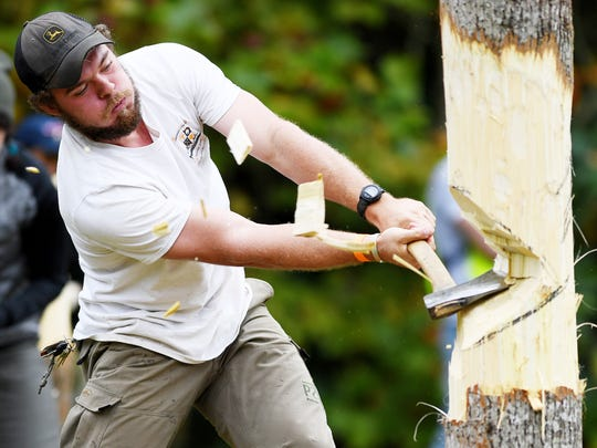 Brad Nellis competes for University of Tennessee in the pole fell competition at the annual woodsmen's meet at the Cradle of Forestry October 7, 2017.