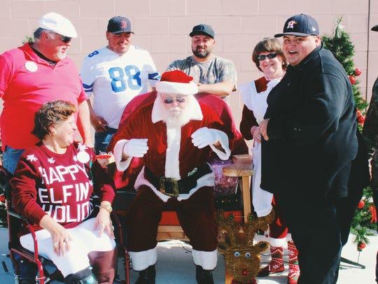The Recios family with dancing Santa