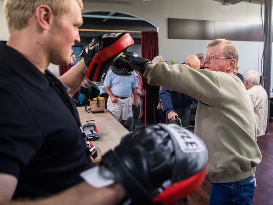 Mike Palmira works with boxing coach Jens Howe during