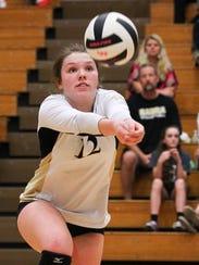 T.L. Hanna's Maddie Bryant bumps a ball againt Hillcrest