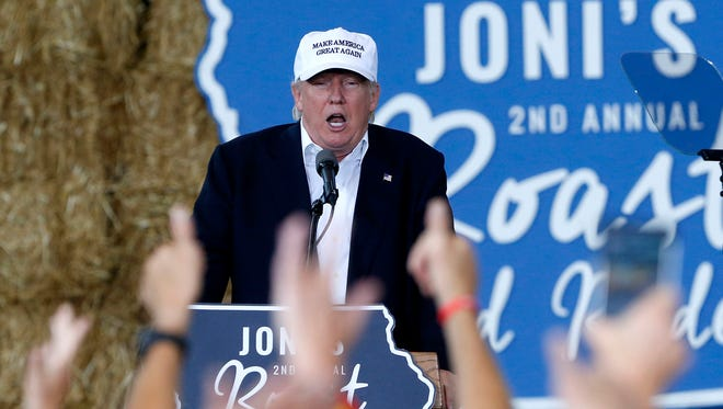"""Republican presidential candidate Donald Trump speaks at Iowa Sen. Joni Ernst's """"Roast and Ride"""" during a fundraiser at the Iowa State Fairgrounds, in Des Moines on Saturday, Aug. 27, 2016."""