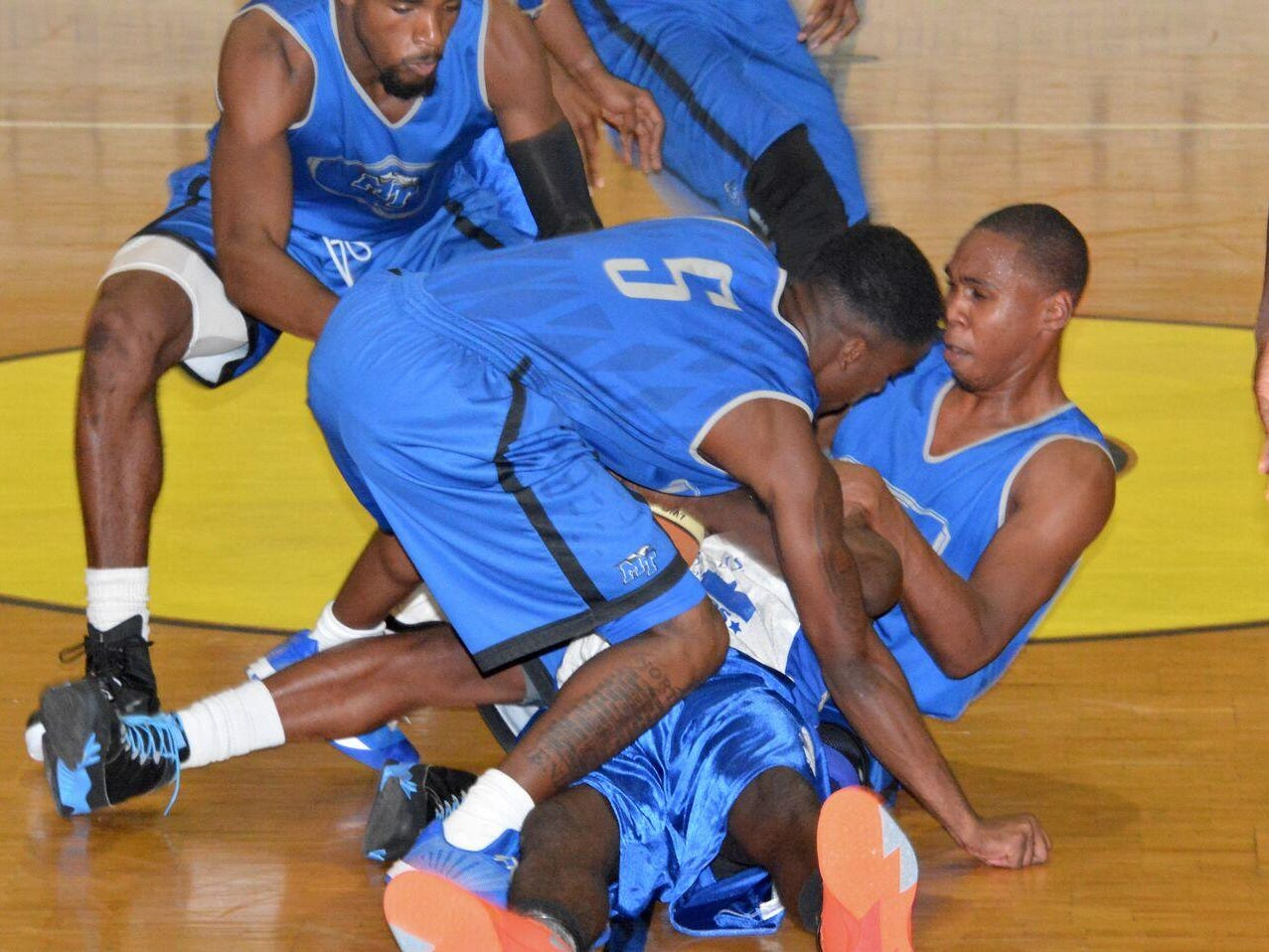 MTSU guards Jaqawn Raymond (right) and Jacob Ivory battle an Atlantis All-Stars player for the ball during Friday night's game in the Bahamas.