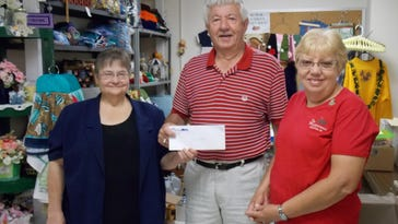 Mary Sladich, from left, of the Clark County Department of Aging, received donated food and $500 from Highground volunteers, Louie Kessler and Mary Dick.
