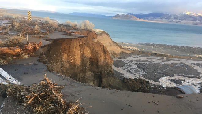 A submitted photo showing erosion damage on Sutcliffe Highway along Pyramid Lake. The flood from the weekend's rain storm created a 50-foot drop along the roadway.