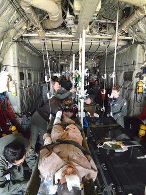 The Delaware National Guard conducts a joint training exercise in 2015 at the Air National Guard base in New Castle. The exercise simulated a tornado disaster and included transporting wounded on Black Hawk helicopters and C-130 transport planes.