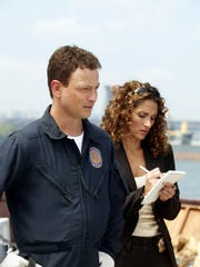 """""""Blink"""" --  Detectives Mack """"Mac"""" Taylor (Gary Sinise, left) and  Stella Bonasera (Melina Kanakaredes, right) examine the evidence on a Staten Island garbage barge as they attempt to track a serial killer, on the series premiere of CSI: NY, Wednesday, September 22 (10:00-11:00 PM, ET/PT) on the CBS Television Network.   --- DATE TAKEN: rec'd 09/04  By Craig Blakenhorn   CBS        HO      - handout   ORG XMIT: ZX26125"""