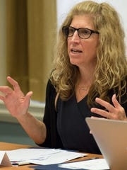 Dr. Karyl Rattay during a Behavioral Health Consortium meeting at the Public Archives in Dover.