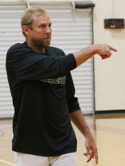 Petal Basketball Coach Todd Kimble gives instructions to his players during practice Thursday.