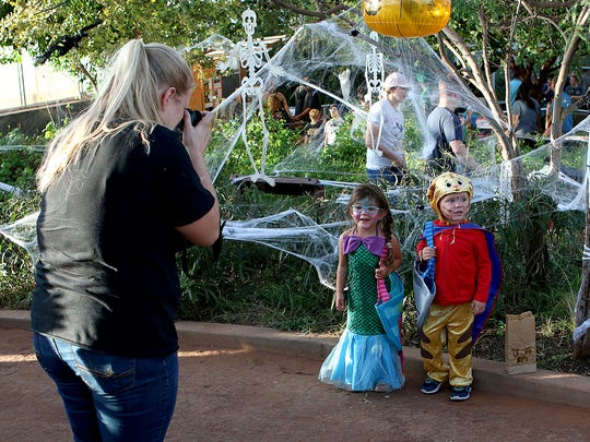 In this file photo, two children pose for photos in the Ruby N. Priddy Butterfly and Nature Conservatory at River Bend Nature Center's Not So Scary Halloween, to be held from 6-9 p.m. Oct. 11.