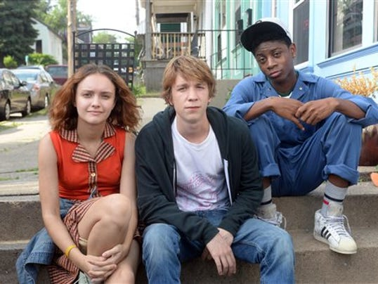 "This photo provided by Fox Searchlight Pictures shows, Olivia Cooke, from left, as Rachel, Thomas Mann as Greg, and RJ Cyler as Earl, in a scene from the film, ""Me and Earl and The Dying Girl."""