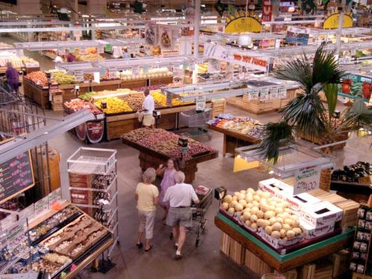 Shoppers walk amongst aisles of produce at Jungle Jim's International Market in Fairfield.
