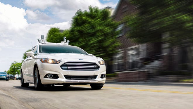 A Ford fully autonomous Fusion Hybrid research vehicle on streets of Dearborn