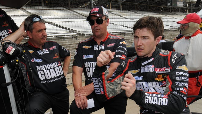 Veteran IndyCar Series engineer David Cripps (center) worked with JR Hildebrand (right) at Panther Racing. They nearly won the 2011 Indianapolis 500.