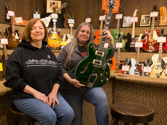 Linda Osborne (left), and her daughter Amy England, of Arthur's Music Store, Indianapolis, Tuesday, Nov. 21, 2017. Osborne took over the store from her father Amos Arthur.