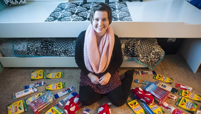 Sheradia Linton, 15, sits surround by school supplies she plans to donate to an orphanage for special needs children in India during her visit with the Make-A-Wish foundation. She suffers from Burkitt's lymphoma, a cancer recognized as the fastest-growing human tumor, but is now doing well.