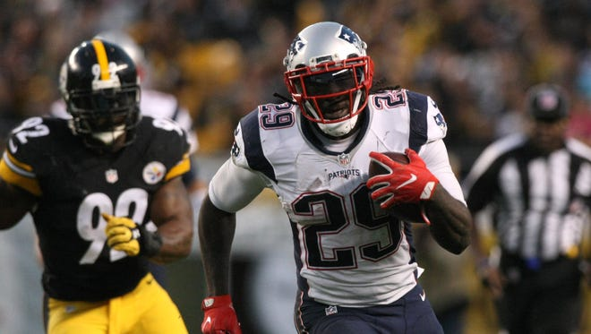 New England Patriots running back LeGarrette Blount (29) runs the ball past Pittsburgh Steelers linebacker James Harrison (92) during the second half at Heinz Field.