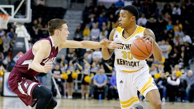Northern Kentucky Norse guard Lavone Holland II (30) works his way around Eastern Kentucky Colonels guard Dillon Avare (4) during the second half at BB&T Arena Sunday December 10, 2017.