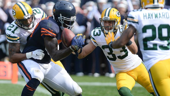 Green Bay Packers defensive backs Ha Ha Clinton-Dix (21) and Micah Hyde (33) stop Chicago Bears tight end Martellus Bennett (88) at the goal line just before halftime of Sunday's game at Soldier Field in Chicago.