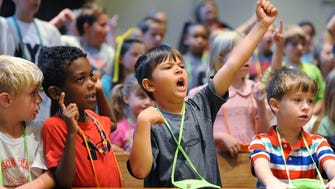 A group of youngsters joins together in song during the opening of Day 2 of Vacation Bible School at Madison United Methodist Church.