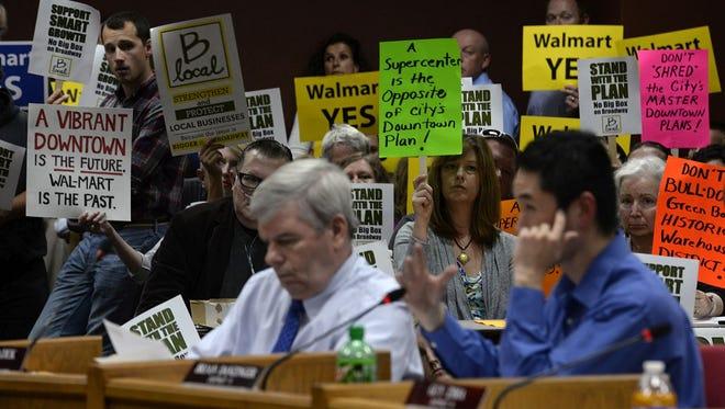 Green Bay City Council member Brian Danzinger asks questions to a Walmart representative during the Green Bay City Council meeting Tuesday at City Hall in downtown Green Bay.