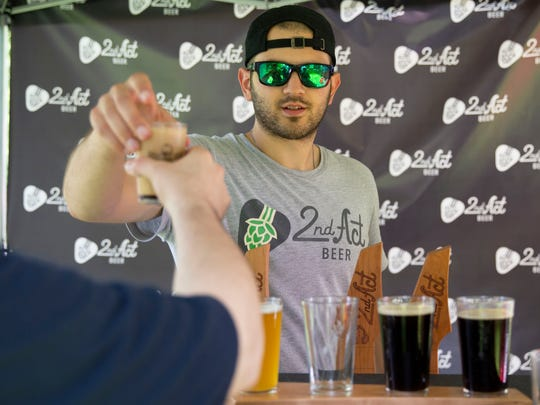 Local Brewer Brandon Galluppi, from Dover, pours a sample of his microbrew 2nd Act during the 2nd Annual Boonton Main Street Rock & Brew Festival held at Canalside Park on Saturday, June 2 2018.