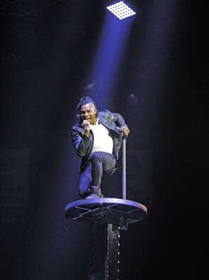 "Michael Tait of the Newsboys performs ""God's Not Dead"" while dropping down from the ceiling to open the 45th annual GMA Dove Awards at Lipscomb's Allen Arena on Oct. 7."