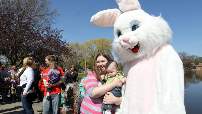 Sarah and Nathan Miller stand by the Easter Bunny, who greets kids at Menominee Park Zoo for the EGG-citing Day at the Zoo event in this 2012 file photo.