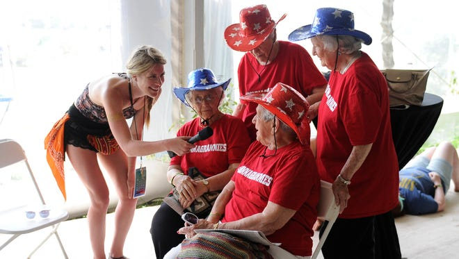 Natalie Labriola of Superfly, which produces the Bonnaroo music fest, interviews Laddie Neil, left; Alice Ann Barge; Nancy Lee Pitts; and Mary Neiderhauser on June 13, 2015, about the group getting free VIP tickets to their third Bonnaroo.