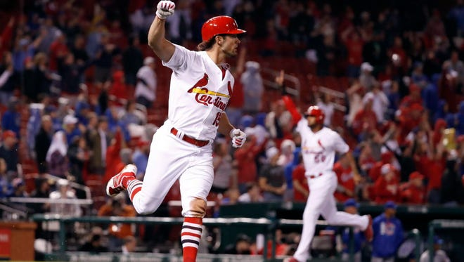 April 2: The Cardinals' Randal Grichuk celebrates after hitting a walk-off single as Jose Martinez  comes in to score the winning run to defeat the Cubs, 4-3.