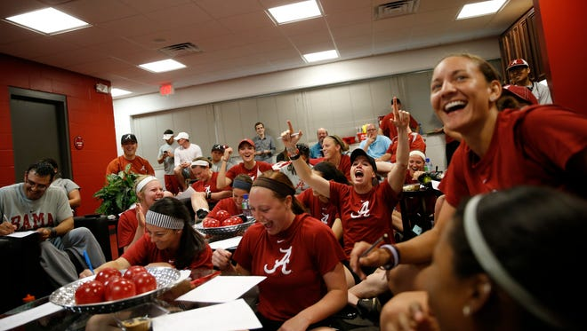 Alabama players react to their selection as the national number two seed in the upcoming NCAA regionals.