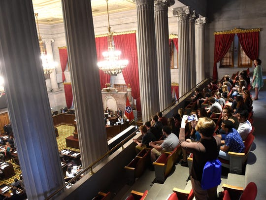 Visitors watch from the balcony as legislators conduct