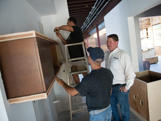Straticon CEO Jeff Hardin (right) works with contractors