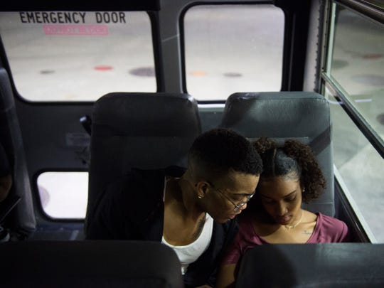 Raymon Henry, left, watches a video with his girlfriend, Kaira Bauer, on the bus ride back to Evansville after he won his fight in the Indiana State Golden Gloves regional semi-championship on Thursday, April 12, 2018.
