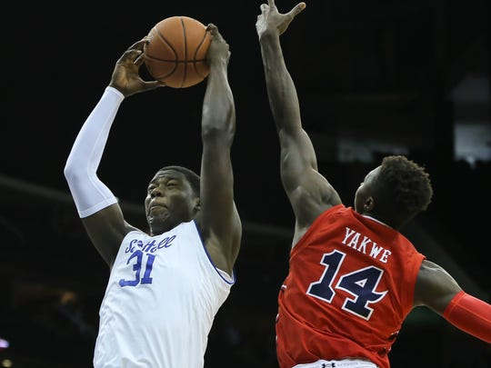 Seton Hall forward Angel Delgado (31) rebounds over St. John's forward Kassoum Yakwe (14) on Jan. 22.