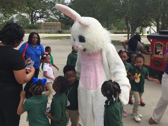 Children visited with life-sized Easter bunnies at