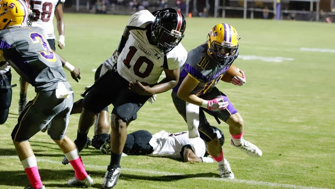 Purvis' Jesse Johnson is kept from the end zone by Lawrence County No. 10, Jeremiah Sumrall.
