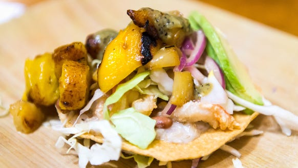 The shrimp tostada prepared with fresh and local ingredients