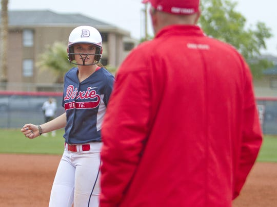 Dixie State runner Sarah Good looks to her first base coach for direction during their game against Azusa Pacific Saturday, April 25, 2015.