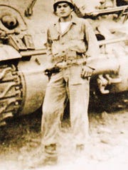 Sgt. Willie Estrada stands in front of his tank.