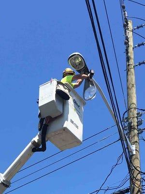 Crews installing high-efficiency LED streetlights in West Nayck on Wednesday, June 28, 2017.