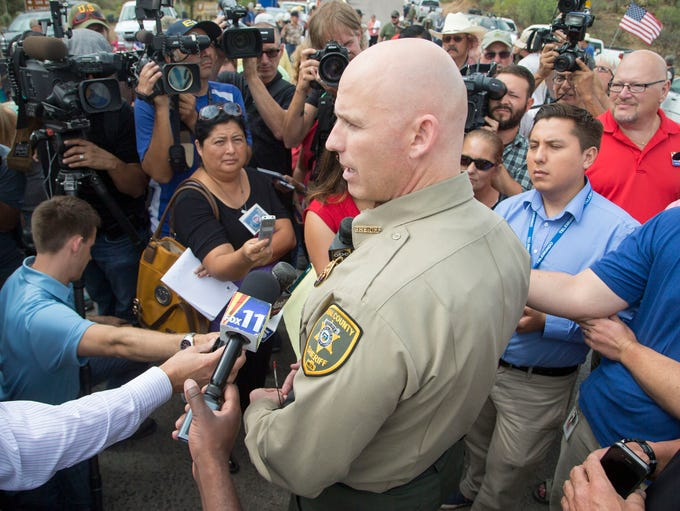 Pinal County Sheriff Paul Babeu said he played peacemaker as protesters and activists waited for a busload of immigrant children heading to a detention facility near Oracle on July 15, 2014.