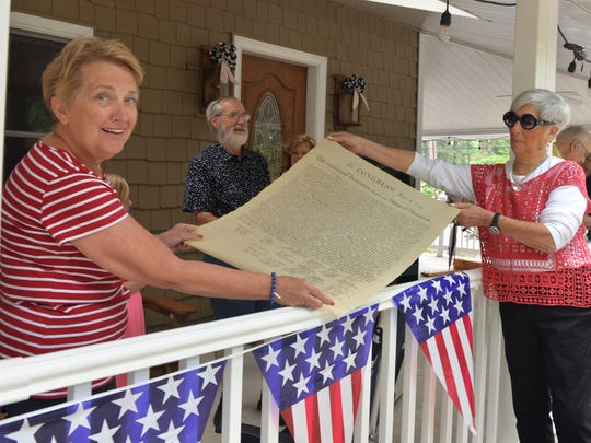 From left, Mt. Gretna residents Ann Kopp and Charlotte Smith display a copy of the Declaration of Independence that was read on Muhlenberg Avenue on Monday, July 4, 2016. The progressive reading was part of a weekend-long celebration hosted by the Pennsylvania Chautauqua.